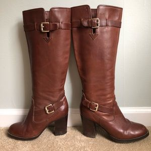 Brown leather boot with stacked heel.